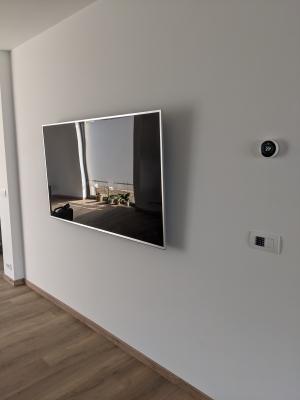 Multimedia en decoder netjes weggewerkt, Nest thermostaat en domotica