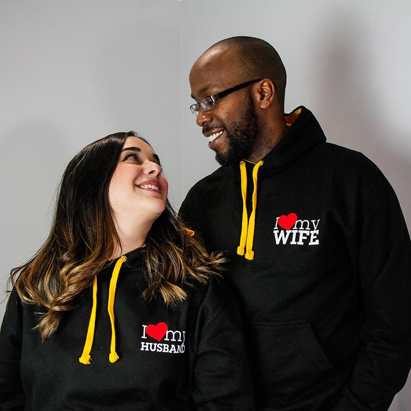 Go Tell Ltd | I Love My Husband - I Love My Wife | Varsity Hoodie | Jet Black Gold