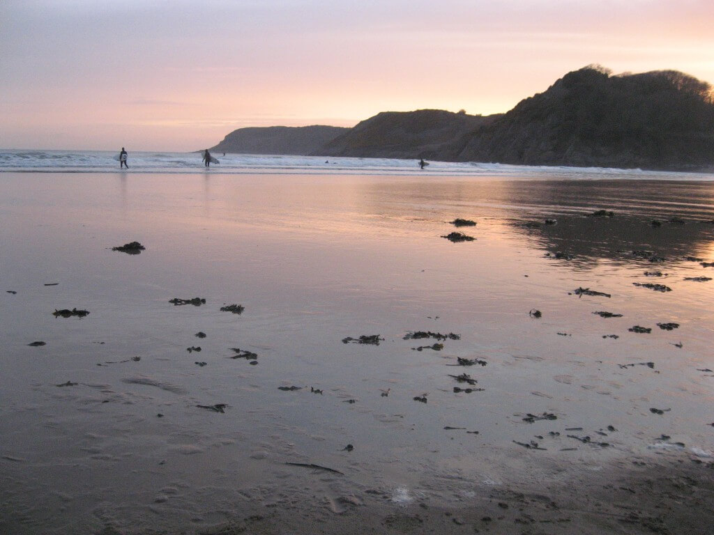 Caswell Bay at dusk a great place to surf on holiday