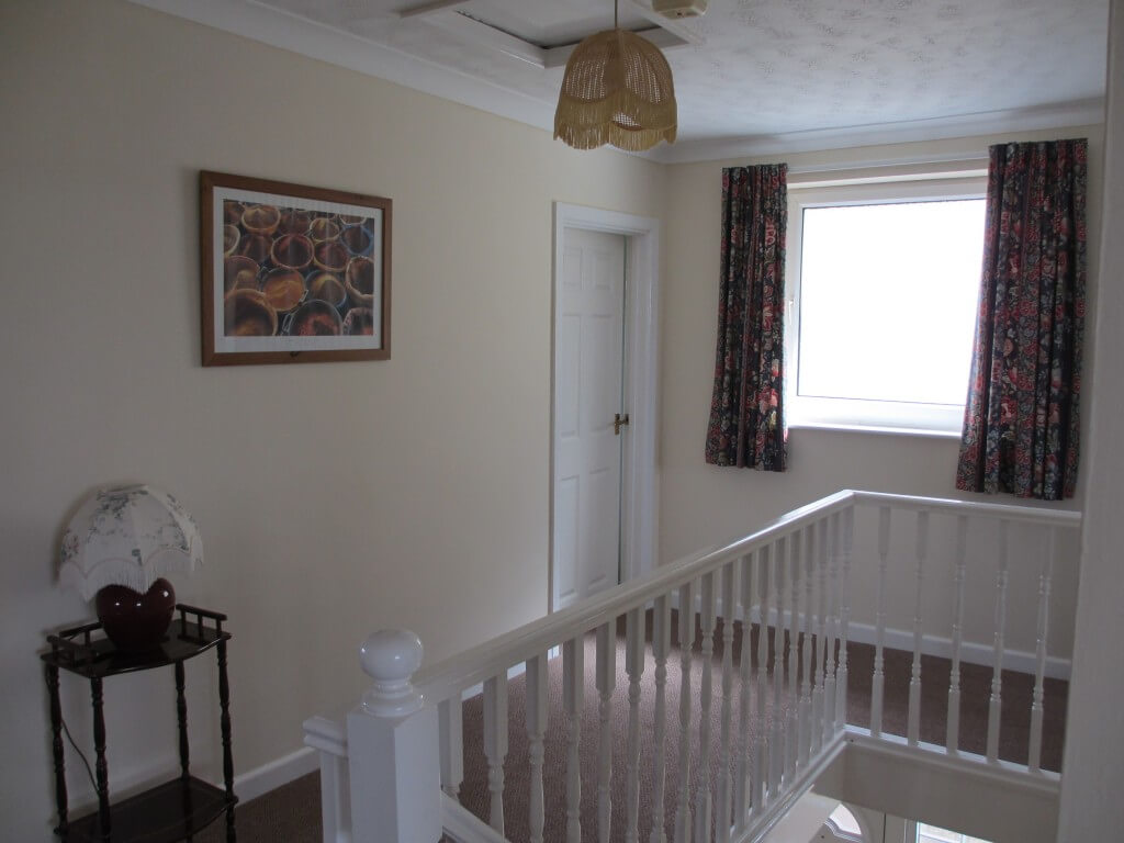 Upstairs there are four large double bedrooms and a family bathroom