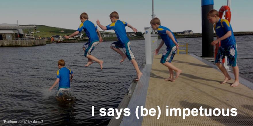 Boy jumping off a pontoon