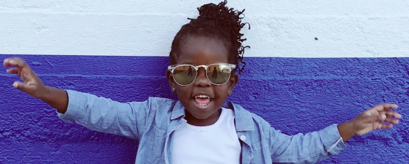 Young girl with afro and sunglasses