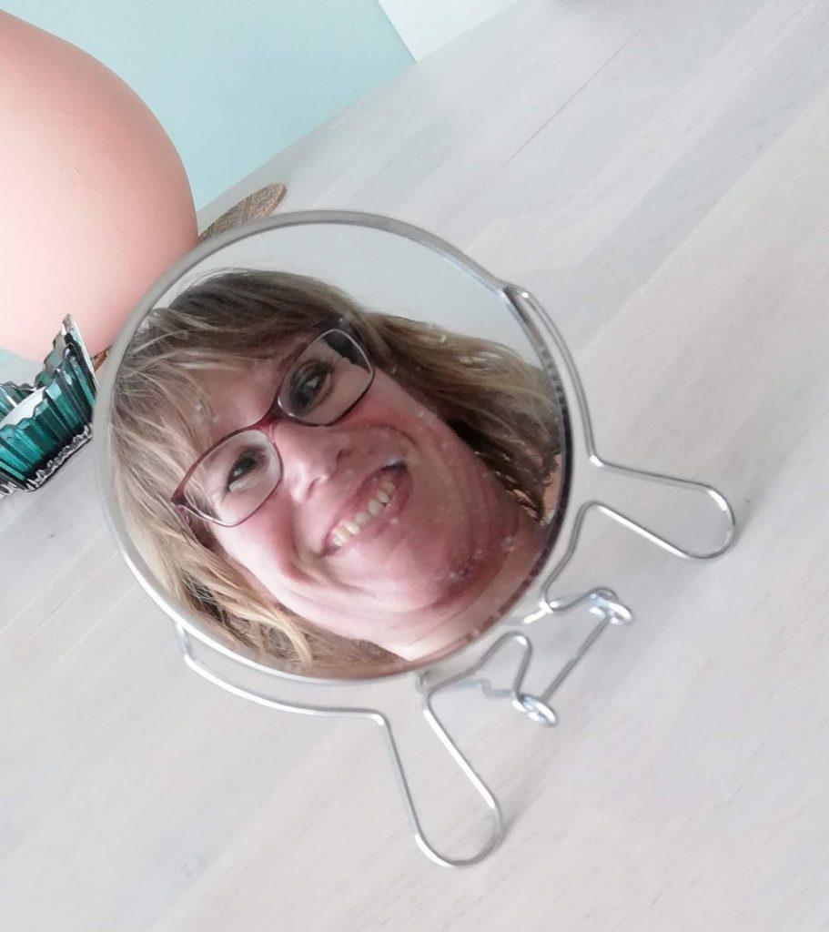 Foto van  mijn gezicht in de spiegel