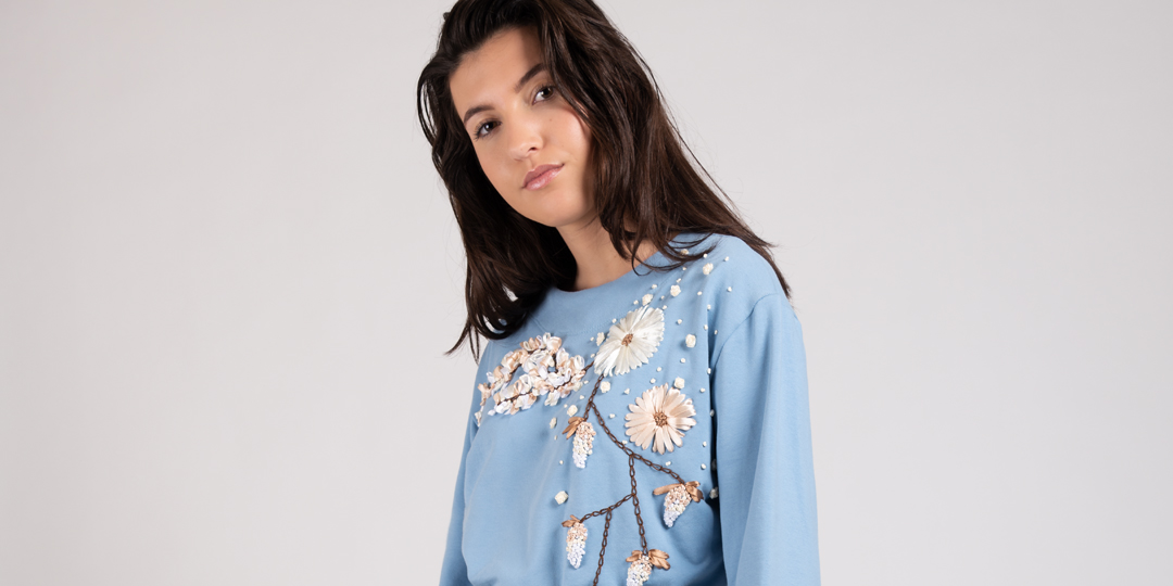 Model wearing hand embroidered flower sweater dust blue Haruco-vert