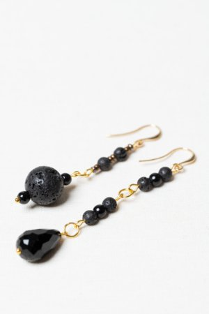 Asymmetrical golden earring set with lava stone and black glass beads