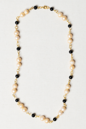Golden necklace with vintage pearls and black beads