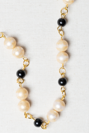 Golden necklace with vintage pearls and black glass beads