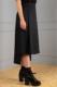 black straight-skirt with drop-tail hemline