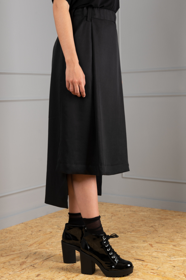 black straight-skirt with drop-tail hemline