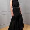 black cotton sleeveless top with black satin belt on broomstick chiffon skirt