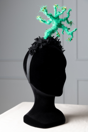 eccentric green statement headpiece
