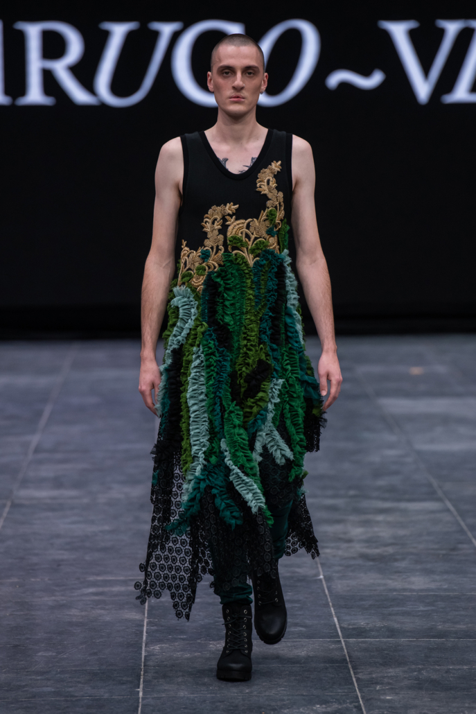 Unisex dress with green ruffles and gold workembroidery
