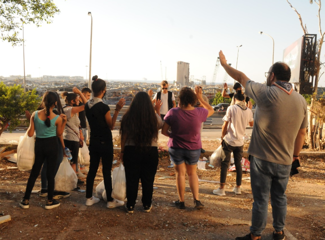 Young People praying in street