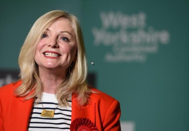 Tracy Brabin Mayor of West Yorkshire in front of WYCA sign