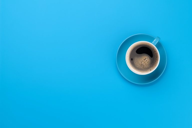 Blue coffee cup over blue background