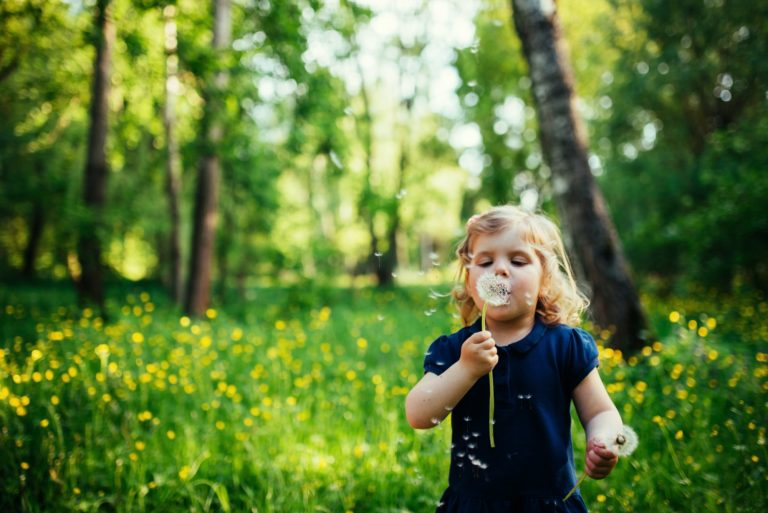 child with dandelion