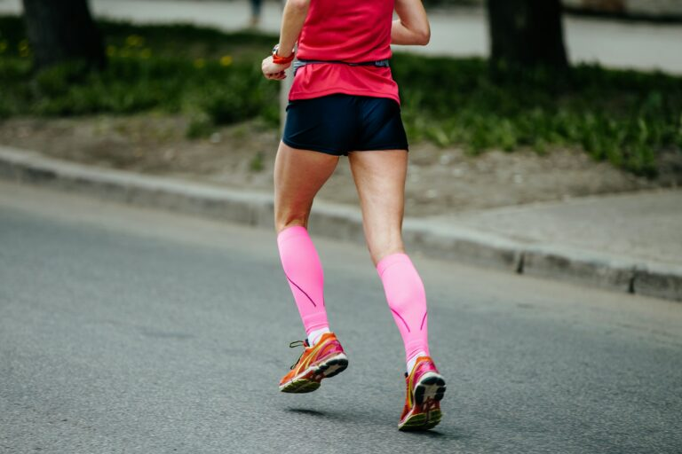 back runner girl in pink compression socks