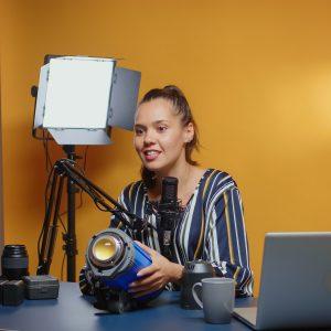 Social media star recording impressions of video lights