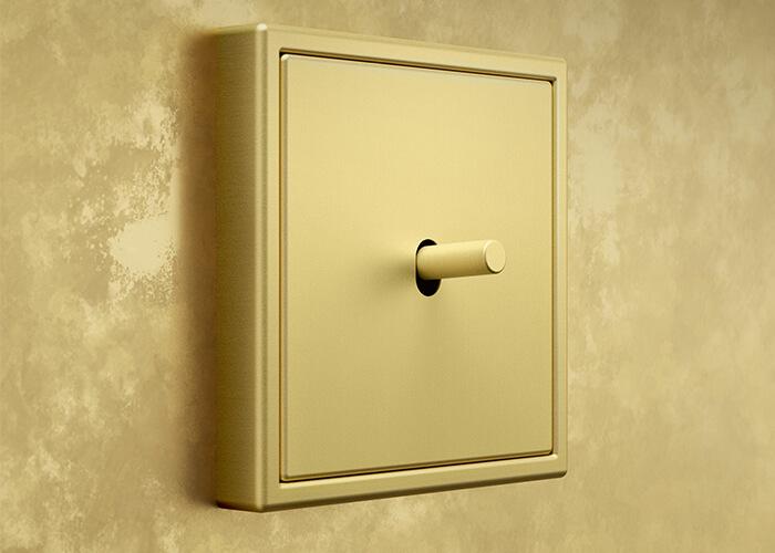 Interruptores de diseño para proyectos integrales de interiorismo LS 1912 latón classic Jung