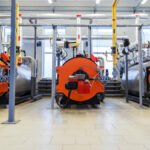 Industry automatical boiler gas burners. Interior of modern boiler house