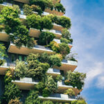 Green futuristic skyscraper Bosco Verticale, vertical forest apartment building with gardens on balconies. Modern sustainable architecture in Porta Nuova district, Milan, Italy.