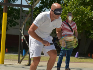 Photo of Blind tennis player playing tennis on outdoor tennis court.