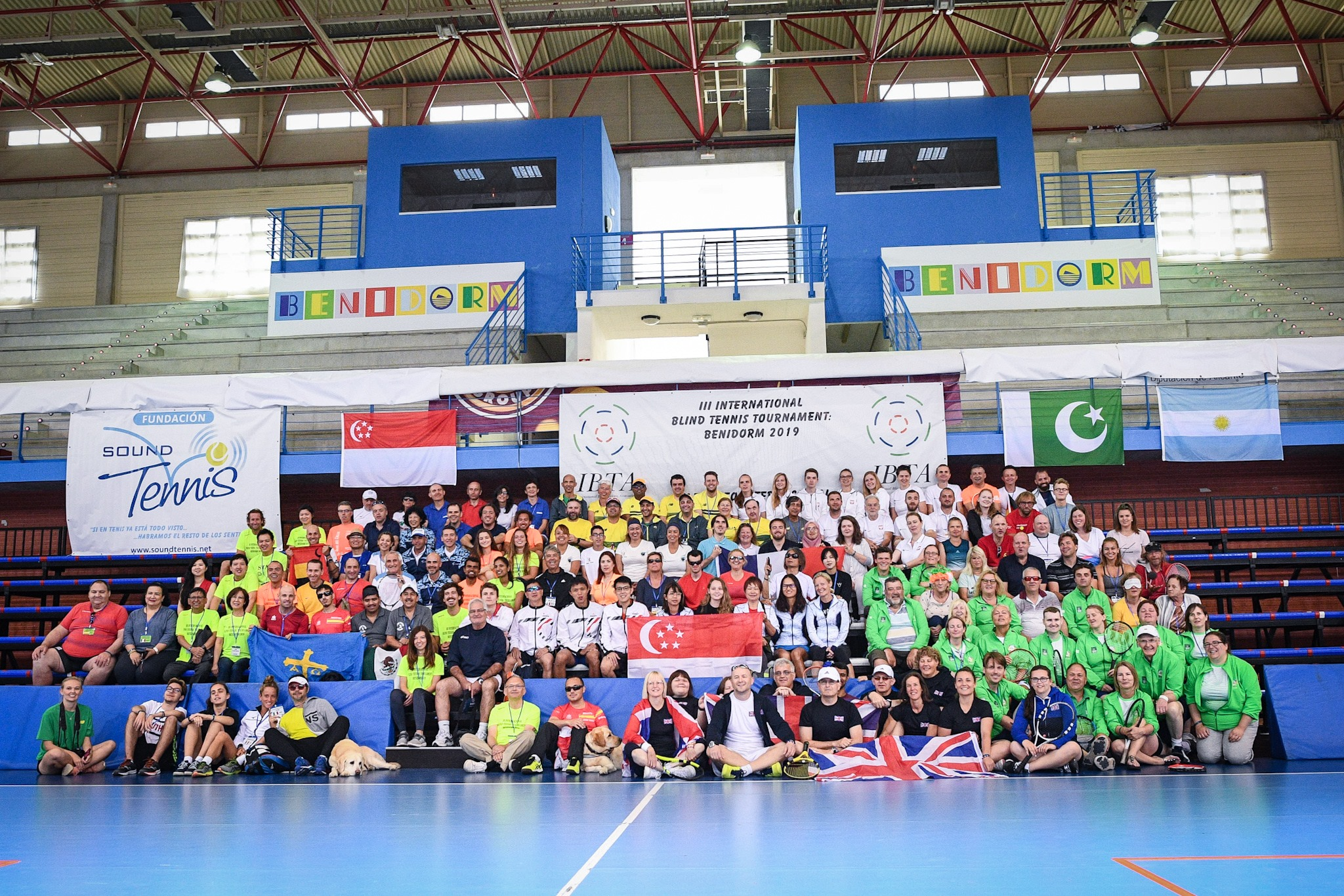 Group photo of the National Tennis teams with blind and visually impaired players from 15 countries at the 2019 IBTA International Championships in Benidorm, Spain.