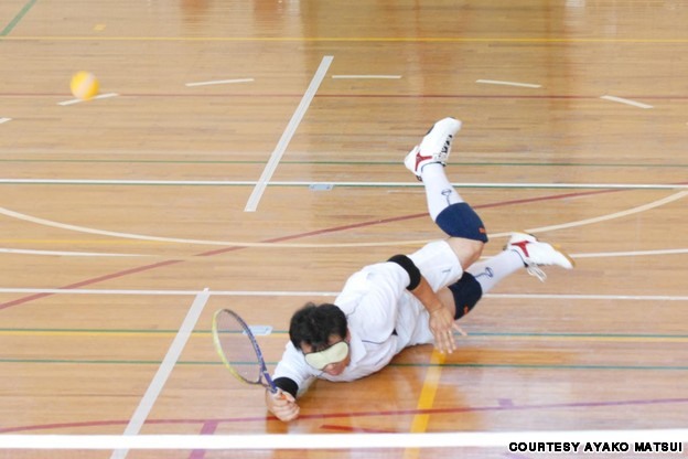 Takei Miyoshi reaching out to the ball for a return of serve