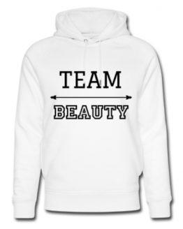 Hvit hettegenser med teksten Team Beauty forran