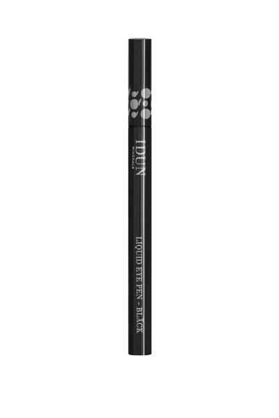 Viser Liquid Eye Pen med kork. Rund, svart holder med hvite pynte detaljer