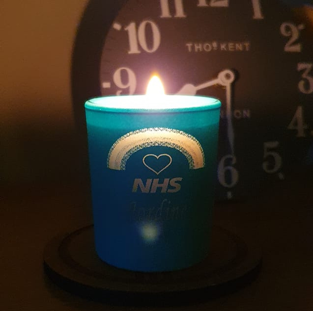 NHS candle alight