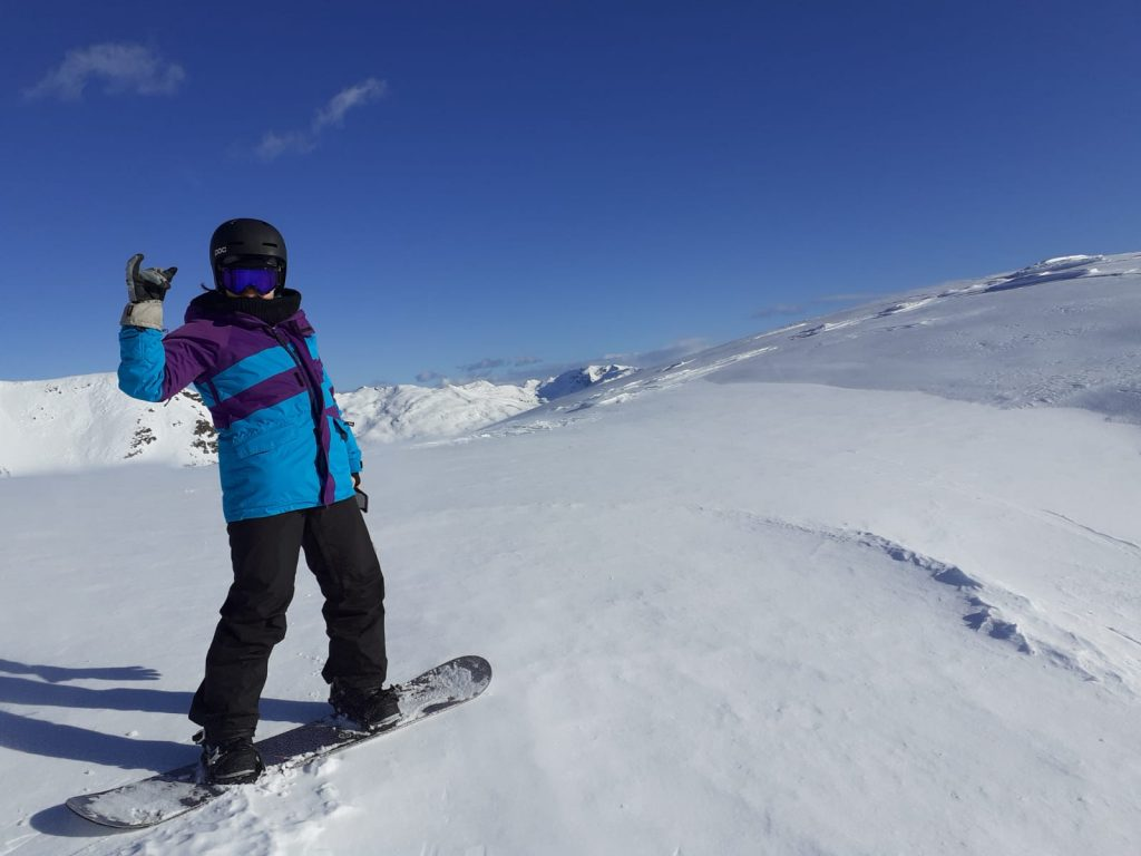snowboarder before blue sky