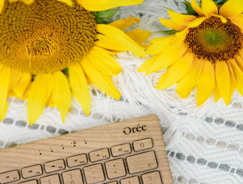wooden keyboard with sunflowers