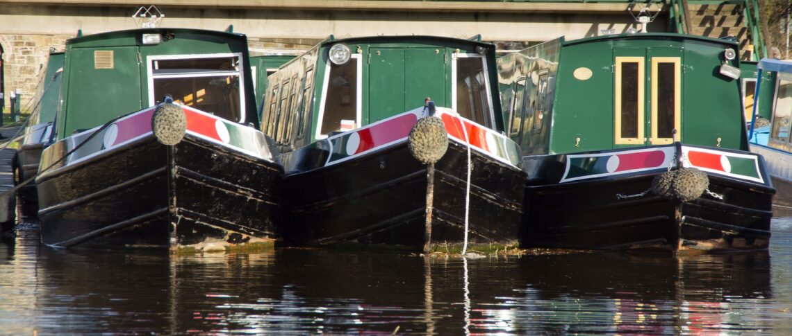 three similar boats next to one another