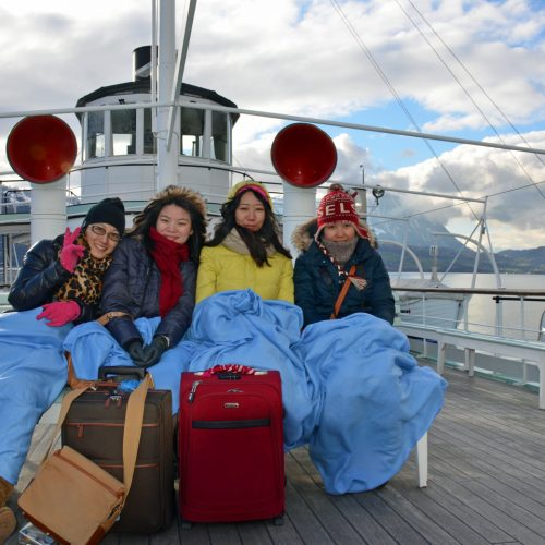boat in winter with guests in blankets