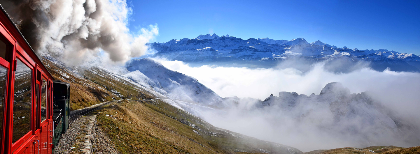 Brienz Rothorn cog railway rising above the clouds