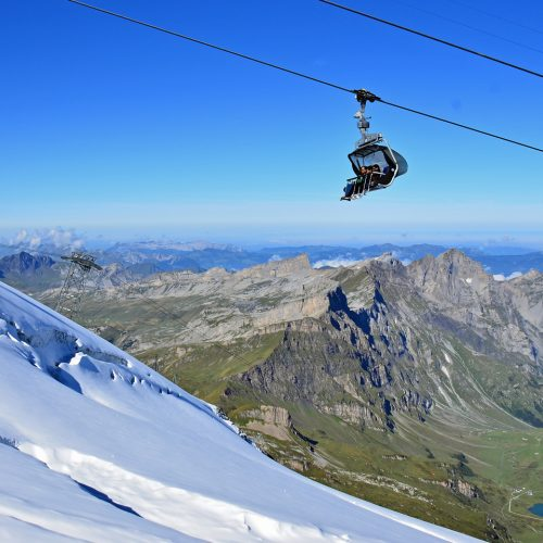 a chairlift high over the glacier and lakes at mount Titlis