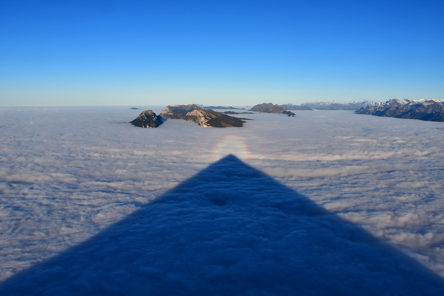 The perfect pyramid shape over the low clouds seen from the Niesen summit,