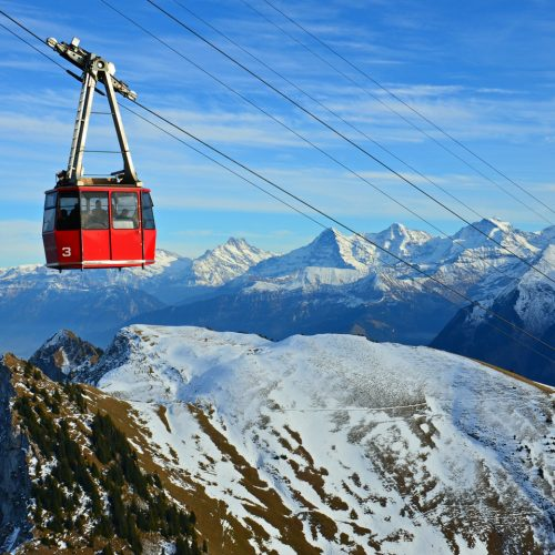 The Stockhorn cable car near the summit and mountains in the background