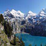 Lake Oeschinen above Kandersteg and the high peaks of the Bluemlisalp range
