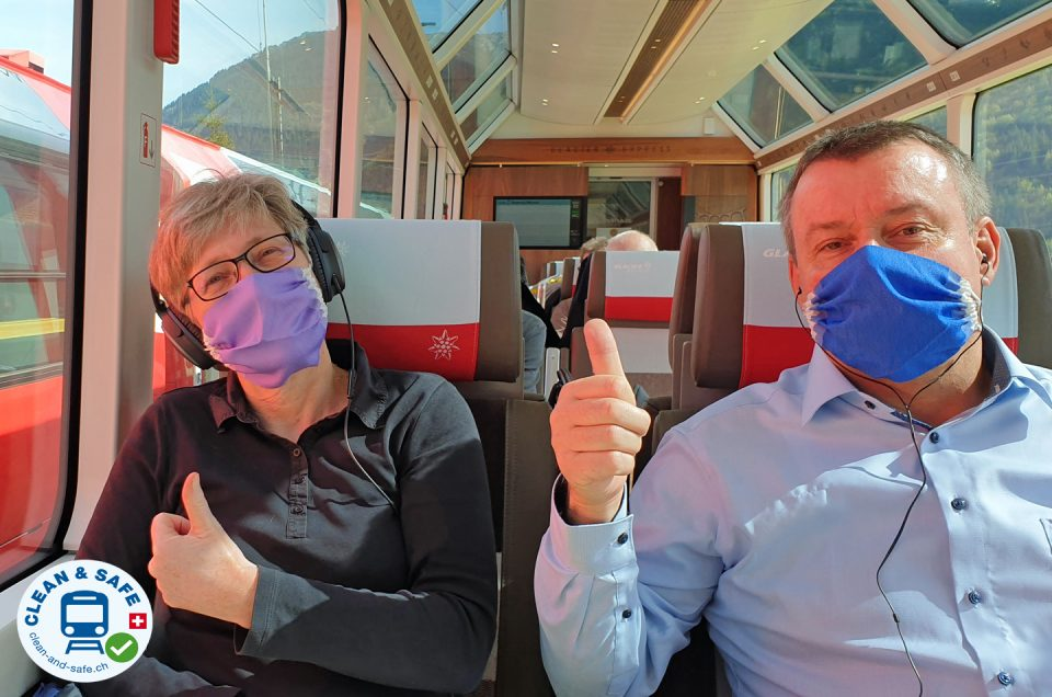 Two travellers wearing masks in the train