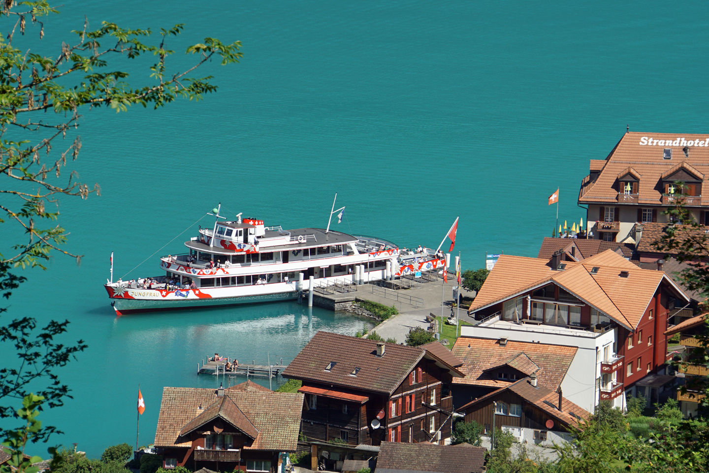 The MS Jungfrau at the boat landing of Iseltwald on Lake Brienz