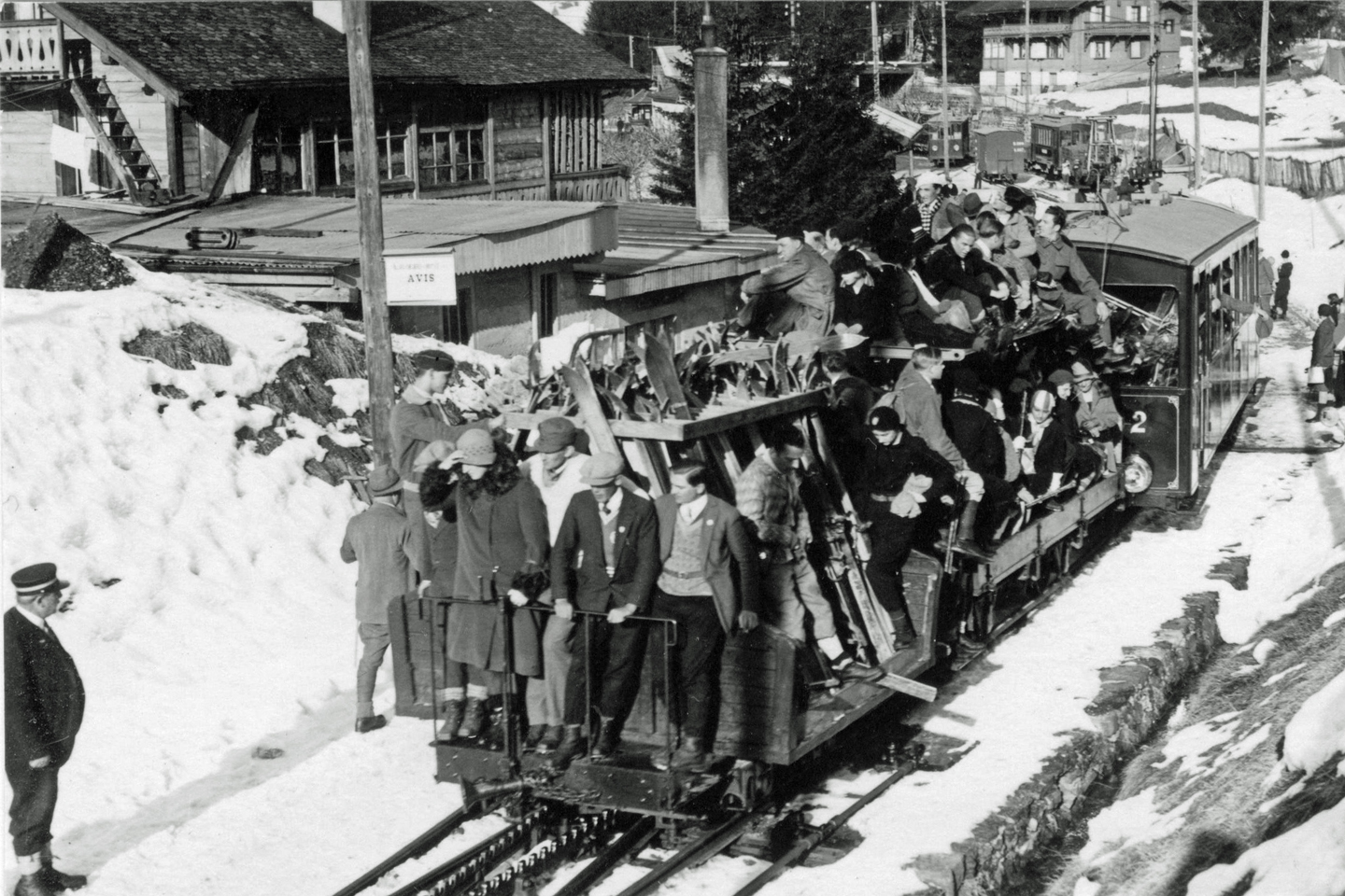 mountain train with skiers
