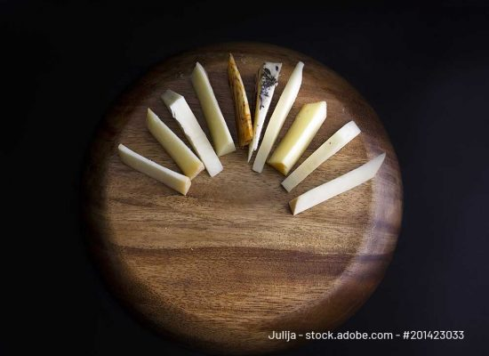 Table decoration of different flavors of cheese