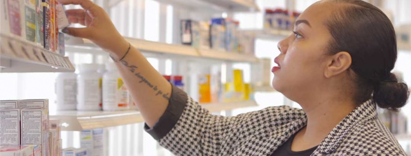 Cassandra, a woman with long, black hair is buying pharmacy products