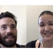 A screenshot of a zoom call with Ian Harding (left), a man with short brown hair and a full beard, and Karina Sturm (right), a woman with shaved brown hair and large, leaf-shaped earrings.