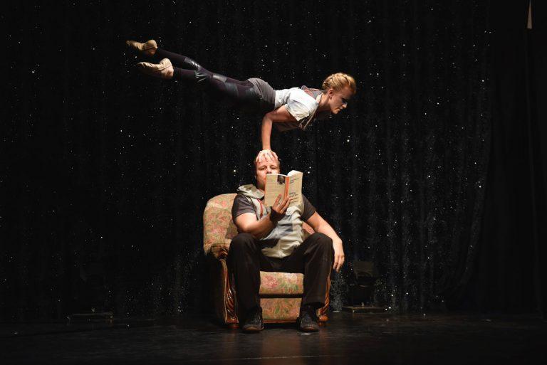two people doing hand to hand acrobatics