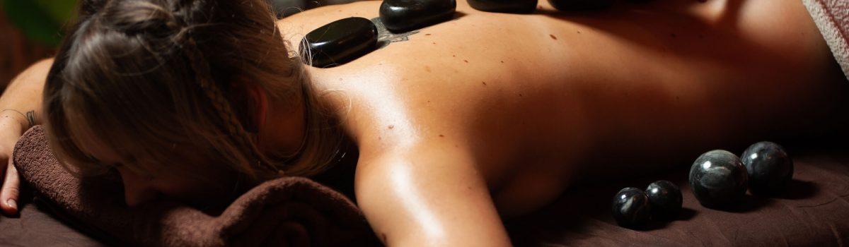 female-enjoying-relaxing-back-massage-cosmetology-spa-centre-less