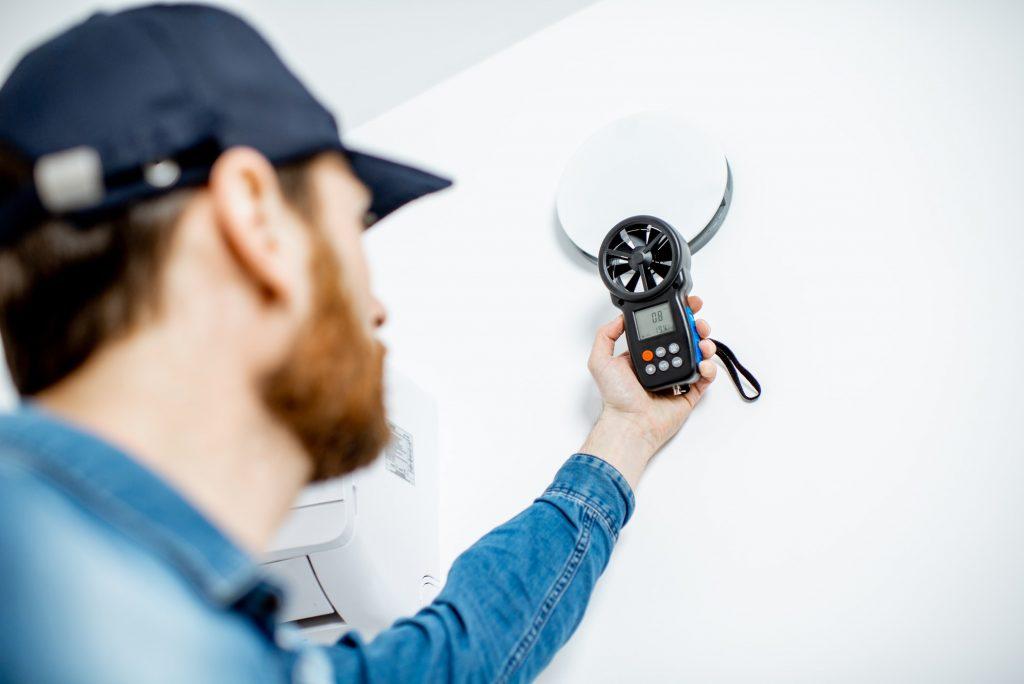 Handyman checking of air ventilation