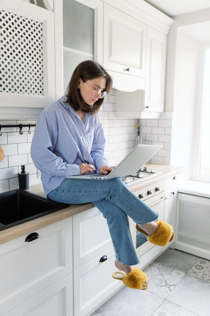 Portrait of woman working on comfortable light space to work at home